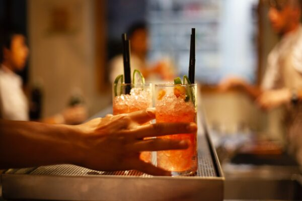 Two mocktails with straws