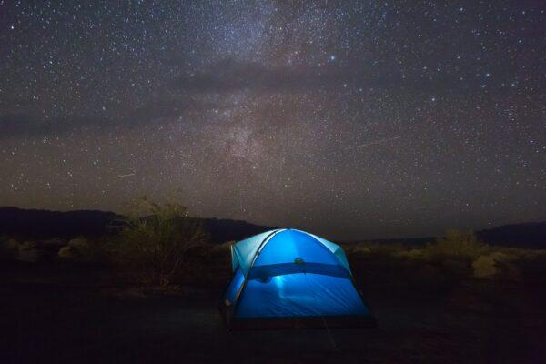 Blue tent under a starry sky