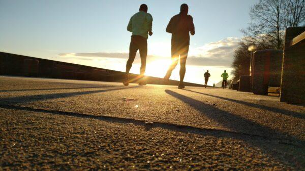Guys running into sunset