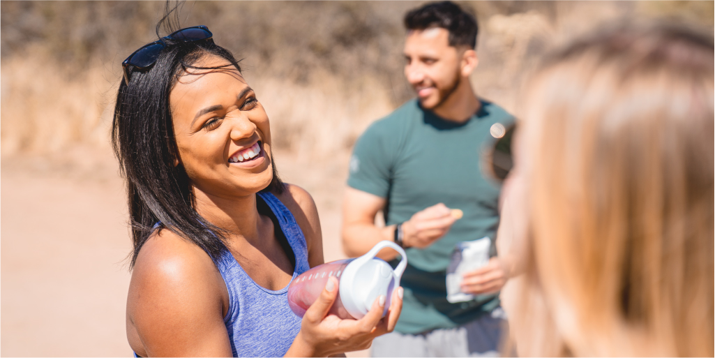 Woman smiling and socializing on a hike