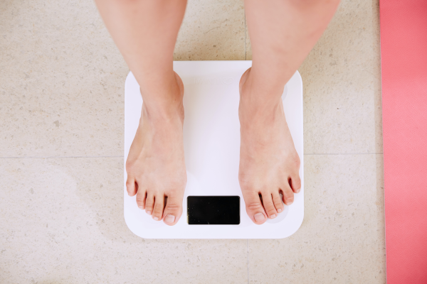 Pair of feet on a white digital scale