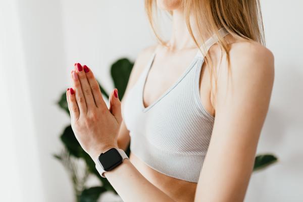 Woman in a sports bra wearing a smartwatch