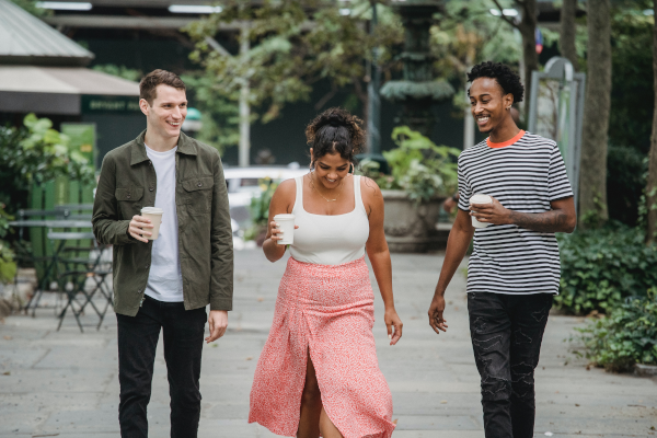Three young adults socializing on a walk